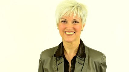 business middle aged woman come into shot and smiles to camera