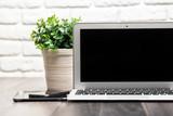 Open laptop on a wooden desk