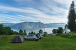 Fjord camping area with cars and tents - 82282557