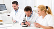 Постер, плакат: Scientists team working together at the laboratory