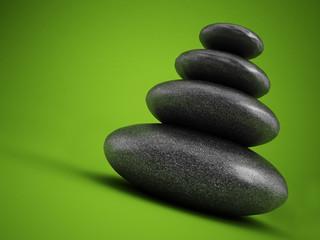 Balanced stones on green