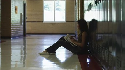 WS DS Female student reading in school corridor / Spanish Fork City, Utah, USA