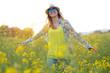 Beautiful young woman enjoying summer in a field. - 82285136