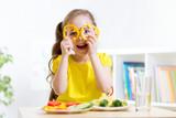 smiling child eating in kindergarten