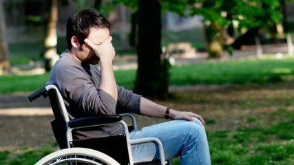 Portrait of a depressed man on a wheelchair