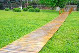 wood pathway in a park