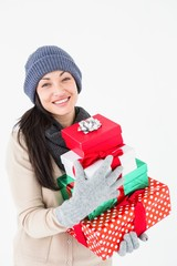 Happy brunette holding gifts