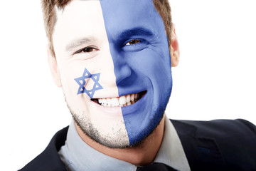 Happy man with Israel flag on face.
