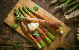 Asparagus Wrapped in Bacon with Curl of Butter