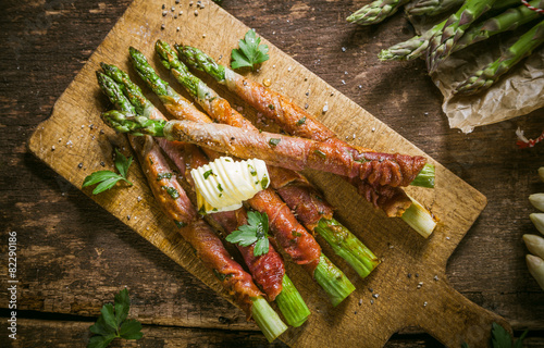 Asparagus Wrapped in Bacon with Curl of Butter - 82290186