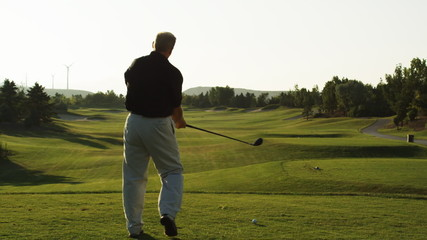 golfer about to tee off