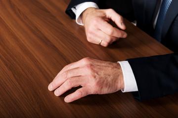 Businessman's hands put on the desk