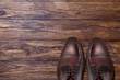 Classic male brown leather shoes on wood - 82295703