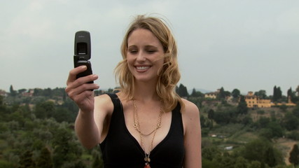 A woman posing for a camera phone