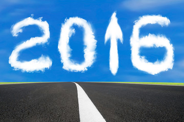 2016 year arrow up sign shape clouds with asphalt road