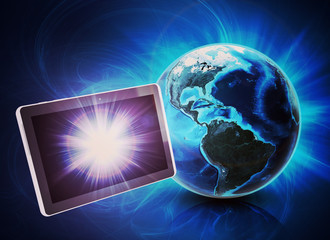 Tablet in front of earth on abstract background