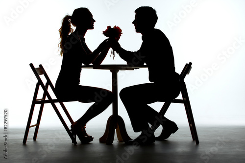 Couple Having Dinner With Wine Glass On Table - 82297520