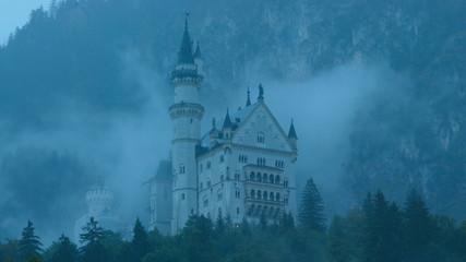 time lapse movie of mist floating across neuschwanstein castle in germany