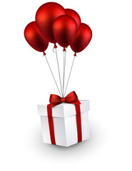 Gift box on red balloons.