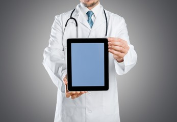 Health. Close up of male doctor holding tablet pc with x-ray