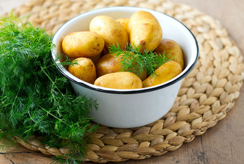 raw baby potatoes on wooden surface
