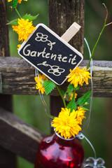 Gartenzeit, Schild am Gartentor