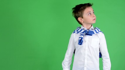 young handsome child boy is suprised - green screen - studio
