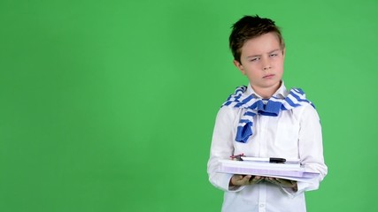 child boy holds textbooks and disagree - green screen - studio