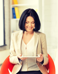smiling businesswoman with tablet pc