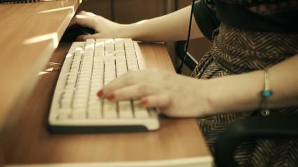 fingers of women  on keyboard