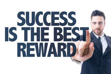 Business man pointing the text: Success is the Best Reward