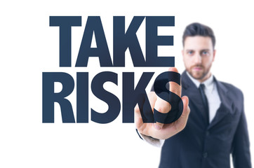 Business man pointing the text: Take Risks