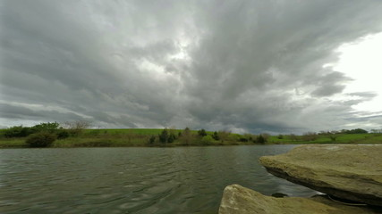 Clouds and rain over lake
