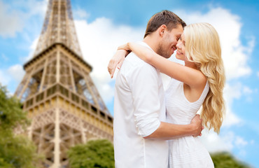 happy couple hugging over eiffel tower