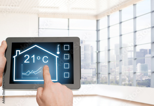 Poster close up of man hands touching tablet pc screen