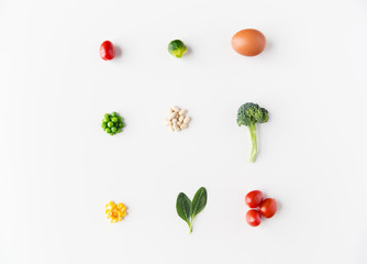 close up of ripe vegetables and food over white