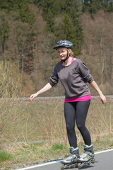Active middle aged woman on inline skates