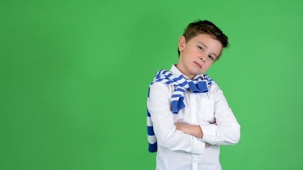 child boy showing thumbs on agreement - green screen