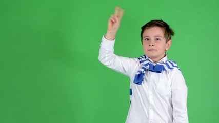 young handsome child boy raise (hold up) - green screen - studio