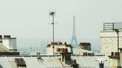 WS HA LS Eiffel Tower over rooftops / Montmartre, Paris, France
