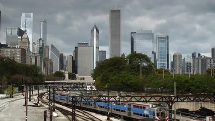 WS Train with downtown skyscrapers in background, Chicago, Illinois, USA