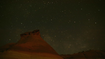 time lapse movie of stars moving across the sky in a mountainous area