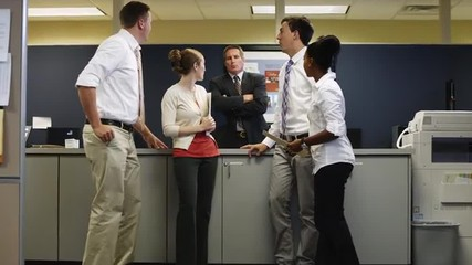WS ZI Manager disciplining four workers chatting in office/ Orem, Utah, USA