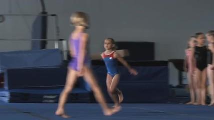 WS PAN Girls (6-7, 8-9) doing somersaults in gym, Orem, Utah, USA