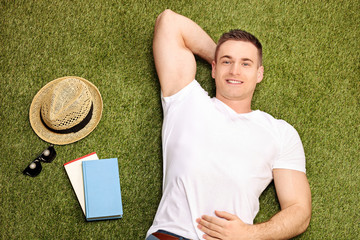 Carefree young man lying on grass