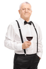 Senior gentleman holding a glass of red wine