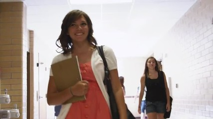 SLO MO MS Female student walking down school corridor / Spanish Fork City, Utah, USA