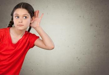 Listening. Little Girl Holding Hand on Ear