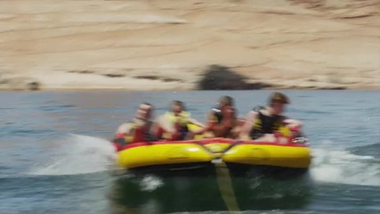 SLO MO BOAT POV WS Tourists (6-15) on inflatable raft / Lake Powell, Utah, USA