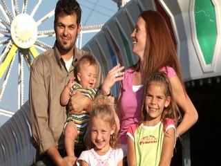 Family posing at amusement park